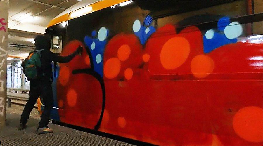 Graffiti Sprayer action in Hangar